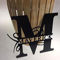 Personalized last name sign featuring your initial in bold. Our custom made last name signs are produced using our in-house CNC and ship fast! These metal signs are made of an aluminum composite material that is perfect for both indoor & outdoor decor. Easily... #customsigns #doorhanger #fencesign