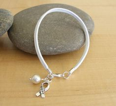 This White cotton Bracelet stands for hope for all the pearl awareness causes. Whether worn for a loved one, self, or just to show awareness; I Hate Cancer, Lung Cancer Awareness, Blue And Green, Letter Charms, Awareness Ribbons, Ankle Bracelets, Bracelet Sizes, Lunges, Anklet