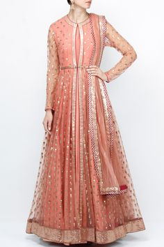 Featuring a salmon pink front open net anarkali jacket with gold metallic sequins bootis and running sequins border. It has a keyhole opening on bodice and maroon piping. It is paired with a pink cut sleeved crepe anarkali inner. It comes with a matching net dupatta with a maroon leheriya border and sequin stripes all over.   Fabric: Jacket & Dupatta: Net; Anarkali: Crepe  Care Instructions: Steam press and dryclean only.