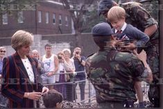 Diana and Prince Harry at Exhibition of Military Equipment, Horse Guards Parade, London - Sept. 1990