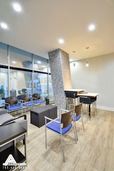 Blue and Stone Waiting Room. Dental Office Design by Arminco Inc.