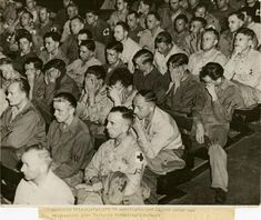 Nazi soldiers react as they are forced to watch footage from concentration camps.