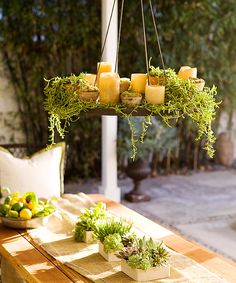 Enhance your patio with the subtle shimmer of candlelight. Place pillar candles on tables, in containers, and in luminaria around your outdoor room. For a romantic glow overhead, group various sizes of pillar candles on a metal disk suspended by chains. Entwine the candles with draping plants such as lysimachia, moss, or ivy.