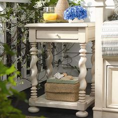 The perfect addition to your living room or den, this country-chic wood end table showcases twisting legs and an open display shelf for added storage.