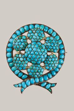 In the Swan's Shadow: Antique Victorian Pave Turquoise Floral and Ribbon Motif Pin, 1860-75