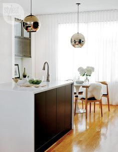 Style at Home - Sarah Blakely's Ottawa home, warm whites, dramatic modern 6 sleek flat-pannelled cherry cabinets staind slate