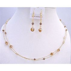 Price :$17.99 Swarovski Copper Crystals Golden Shadow Smoked Topaz TriColor Necklace Material Used : Genuine Swarovski crystals Necklace Length : 16 inches with 2 inches extension Earrings Length : 1 inch long Earrings Type : 22k Gold plated French Hook