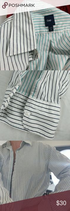 """Men's Gap  pin striped button down shirt M Excellent condition!  100% cotton.  Pin stripes have a texture. Small slight stain, as shown.  Machine wash warm.  Tumble dry low.  30"""" top to bottom, not including the collar.  22"""" arm pit to arm pit.  20"""" arm pit to end of sleeve; 26"""" shoulder seam to end of sleeve.  7.5"""" collar seam to shoulder seam. GAP Shirts Casual Button Down Shirts"""