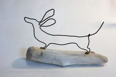 Wire dachshund on driftwood