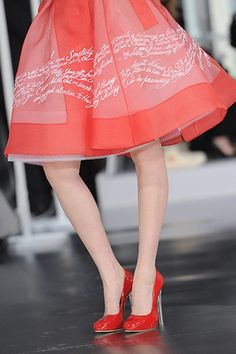'Elegance must be the right combination of distinction, naturalness, care and simplicity' was the motto hand-embroidered in organza on to the skirts of several dresses at Dior