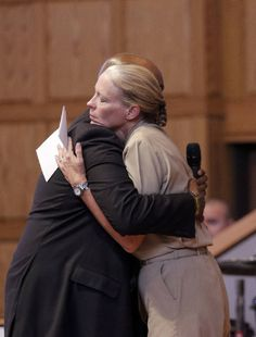 Chattanooga Public Safety Coordinator Paul Smith, left, hugs U.S. Navy Rear Admiral Mary Jackson before she speaks at an interfaith vigil at Olivet Baptist Church held in remembrance of victims of the July, 16 shootings on Friday, July 17, 2015, in Chattanooga, Tenn. The vigil was held one day after gunman Mohammad Youssef Abdulazeez shot and killed four U.S. Marines and wounded two others and a Chattanooga police officer. Photo by Doug Strickland /Times Free Press