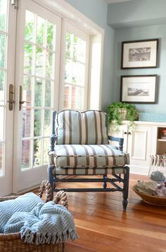 White trim with robins egg blue walls in bedroom. B&W photos.
