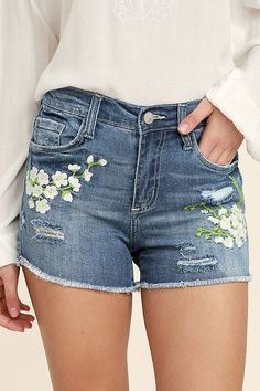 Prance in the fields in the Through the Meadow Medium Wash Embroidered Denim Shorts! Medium wash denim has a mid-rise fit with top button, hidden zip fly, and a five-pocket cut. White, yellow, and green floral embroidery trims the front, while distressing and frayed hems give these shorts a well-loved look.