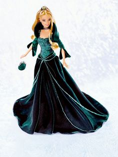 2004 Holiday Barbie - For over a decade, Barbie doll has celebrated each holiday season with a special edition doll commemorating the year. In 2004, Holiday Barbie Doll joins the proud tradition dressed in rich, green velvet embellished with glittering sparkles. The year's end brings a beautiful world of shimmering frost and perfect snowflakes. During this glorious holiday season, we receive the best gifts of all: family festivities, friendships renewed, and wonderful memories.