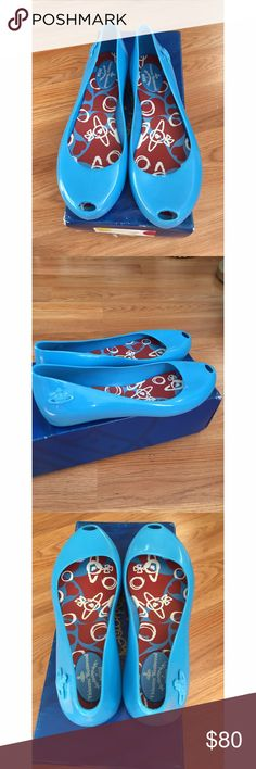 Vivienne Westwood open toe flats This is super cute sky blue flats. smells like candy VW Melissa. open toes. fits true to size. super comfortable! wore only few times. size 7 Vivienne Westwood Shoes Flats & Loafers