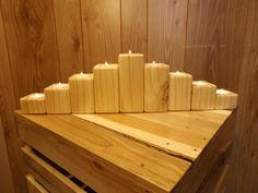 "This nine piece set of Southern Yellow Pine Tea Light Holders was made from the timbers of a large pallet. The holders show nice even color and grain pattern and there are a few nail holes that adds to the charm. This set of holders would go great on the mantle or a large dining table. The height of the holders are 1 1/2"", 2 1/2"", 3 1/2"" 4 1/2"" & 5 1/2"". The width of the holders is 2 3/4"". Nine Tea Light Candles are included. http://www.crafttables.net"