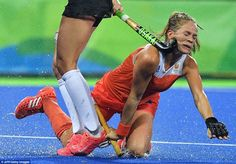 Ouch: Netherlands hockey star Kitty van Male (right) is hit  by Argentina's Agustina Habif during yesterday's quarter-final