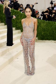 """The 2021 #MetGala is here! Fashion's biggest night is back, and this year the theme is """"In America: A Lexicon of Fashion,"""" a true celebration of American fashion. Hit the link to view every #celebrity #redcarpet arrival. Zoe Kravitz, Donatella Versace, Keke Palmer, Anna Wintour, Jennifer Hudson, Jennifer Lopez, Thom Browne, Tessa Thompson, Teyana Taylor"""