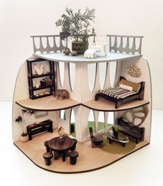 A beautiful laser-cut dollhouse for kids and collectors alike with matching furniture.
