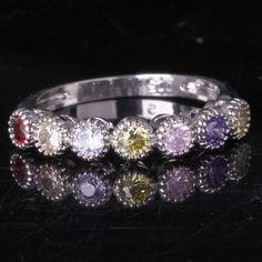'SS Garnet Green Amethyst Pink Topaz Eternity Ring Sz 7' is going up for auction at  9am Sat, Aug 10 with a starting bid of $5.