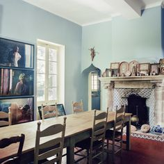 The dining room, with a grid of Goldin's photographs on the far wall.-Wmag