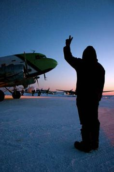 """Ice Pilots: A rampie signals the """"all clear"""" for Joe to start the number two engine on the DC-3. Photo credit: John Driftmier"""