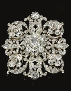 An antique diamond brooch, mid 19th century, of openwork cluster and scroll design, set with cushion-shaped and rose diamonds. #Victorian #antique #brooch