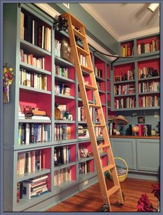 rolling library ladder for bookshelf wall. Could DIY? Add shelf halfway up, hinged so it can swing in flush with the risers, then swing out for placing books when standing up top.