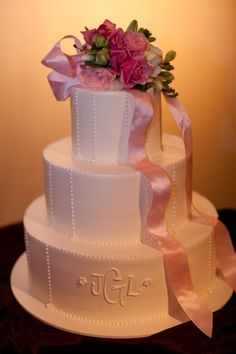 wedding cake designed just like my dress plain and simple with buttons