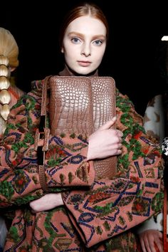 Crocodile clutch and geometric embroidered leather coat backstage at Valentino AW14 PFW. More images here: http://www.dazeddigital.com/fashion/article/19155/1/valentino-aw14