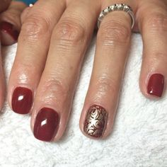"""CND Shellac """"Burnt Romance layered with Ruby Ritz"""" with MoYou stamping on accent nail using Barry M foil effect polish."""