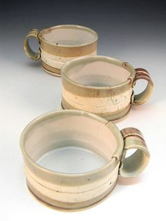 Oh my gosh! I LOVE these!  Hand Built Cappucino Cup  Oval by lbcooper on Etsy
