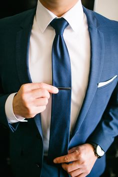matching blue suit and tie, photo by Jenna Bechtholt http://ruffledblog.com/los-angeles-rooftop-wedding #grooms #tieclip