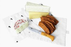 "Artist Mimi O Chun's plushy sculpture, ""Triple Cream Dream: Assorted Cheese, Crostini, and Opinel Knife from Cowgirl Creamery."""