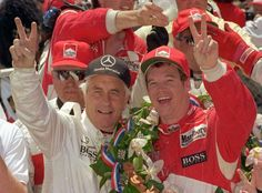 Al Unser Jr., right, celebrates with car owner Roger Penske in the victory circle after winning the 1994 race. Two years earlier, Unser Jr. became the third member of the Unser family to capture an Indy 500 title.