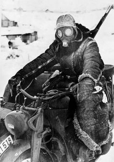Eastern Front, February 1942: Riding a motorcycle in minus 40 Celsius calls for some innovative tactics, including wearing an otherwise useless gas mask as protection against the cold. Note the heavy shearling coat. That the motorcycle would run at all was testimony to German engineering.