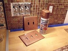 Use Rustoleum hammered copper paint on electrical switch cover plates.