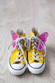 Butterfly converse... I have to have these for my little girl... When she comes lol