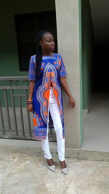 Materials: dashiki fabric, 100 percent cotton, Zipper, Lining Handmade Ships worldwide from Nigeria. This dashiki kimono is made from African fabric. The fabric is 100% cotton. It could be worn all year round. Please allow 6 to 8 business days for processing This item is a made to order product. Kindly forward the following measurements in inches;  Shoulder to shoulder Bust measurement Waist measurement Hip measurement Dress length Please feel free to start an etsy conversation.