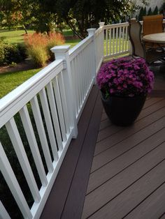 White vinyl railing with Azek decking in the colors Brownstone with a Kona border in Oak Ridge NC by Archadeck of the Piedmont Triad.  what a great look.