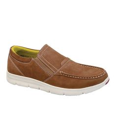 Boost his laid-back look with these leather slip-ons that feature a contrasting sole for a pop of refined color.