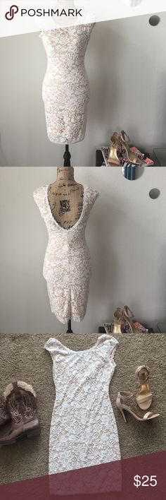 Lace Dress This is a beautiful lace dress! In great condition and only worn once. It is form fitting and will hug your body. It has a nice v back and it also has nude lining. It goes great boots or heels. Shell: 90% Nylon, 10% Spandex. Lining: 100% Polyester. Dresses