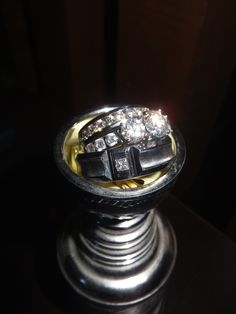 Were huge hockey fans.. so we have a mini stanley cup, and i put our wedding bands in it!!