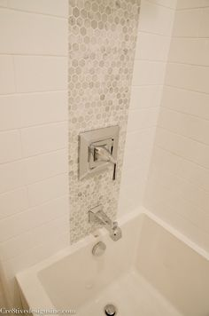 Using accent tiles to tie the plumbing fixtures together is a neat idea.  Keeps it from looking like plumbing pox.