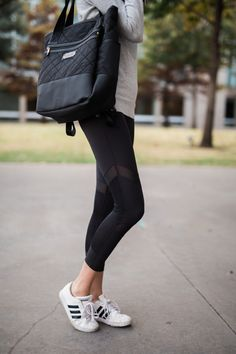 the miller affect wearing black workout leggings from day to night