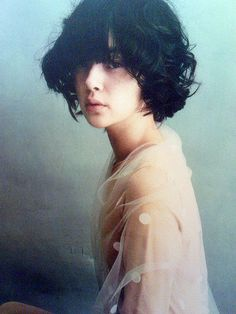 Short curls with bangs, and an ethereal look. I think slightly shorter on the bangs.