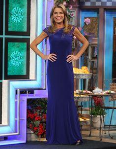 MIGNON: Cobalt blue jersey gown w/blue illusion shoulders enhanced in blue beads, scoop neckline, cap sleeves, flared hemline w/train | Vanna White's dresses | Wheel of Fortune