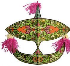 This beautiful Malay Wau Kite with a astounding harmonious colors and floral motif, is traditionally seen dancing in the cerulean sky after the rice harvesting season is over. A Wau or Kite is complimented by a hummer that makes buzzing and purring sounds when soaring upon the wind. This Wau Kite sets a truly mystical scene as it climbs and sways into the wind, defying gravity.