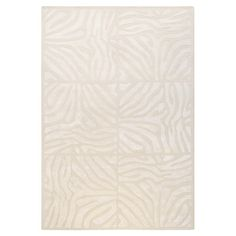 Anchor your living room seating group or define space in the den with this artfully hand-tufted New Zealand wool rug, featuring a zebra-print motif for exoti...