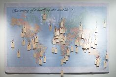 DIY Travel Wishing Map. I imagine having this in the upstairs hallway and the future kiddos could put up their wishes as well.
